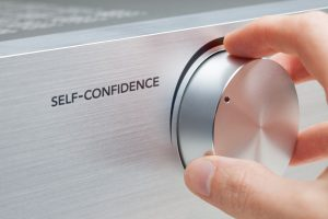 Self-confidence improvement concept. Coach or mentor help to increase self-confidence. Knob with hand representing growth.